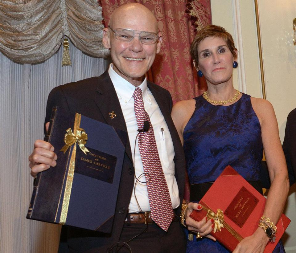 Honorees James Carville and Mary Matalin accept their bound genealogies from NEHGS president and CEO Brenton Simons.