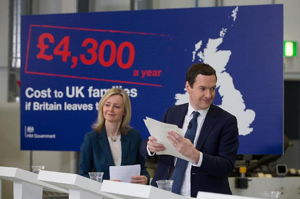 "British Chancellor of the Exchequer George Osborne (R) and British Environment Secretary Liz Truss address invitees at an event at the National Composites Centre at the Bristol and Bath Science Park in Bristol, south-west England on April 18, 2016. If Britain leaves the European Union its economy could be six percentage points smaller than it would otherwise have been by 2030, the finance ministry warned in a report on that was dismissed as scaremongering by eurosceptics. The report said a Brexit would cause ""permanent"" economic damage as Britain would never be able to negotiate quota-free, no-tariff access to the single market if Britons vote to leave in a June referendum. / AFP PHOTO / POOL / Matt CardyMATT CARDY/AFP/Getty Images"