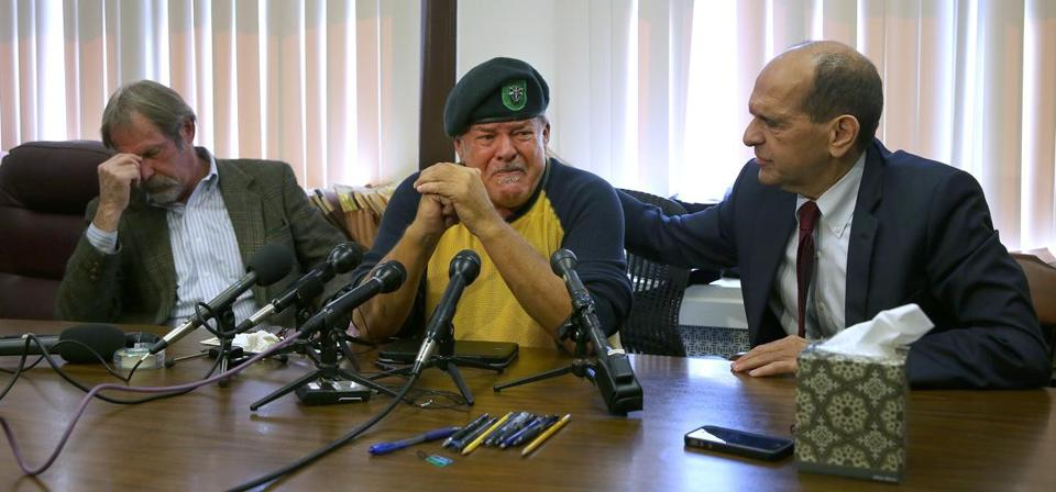 Adrian Hooper (left) and John Sweeney spoke at a press conference with their lawyer, Mitchell Garabedian (right).