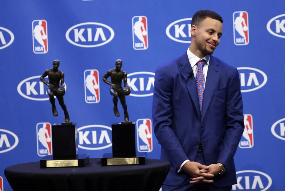 Golden State Warriors Guard Stephen Curry Smiles After Being Presented With The NBAs Most Valuable Player