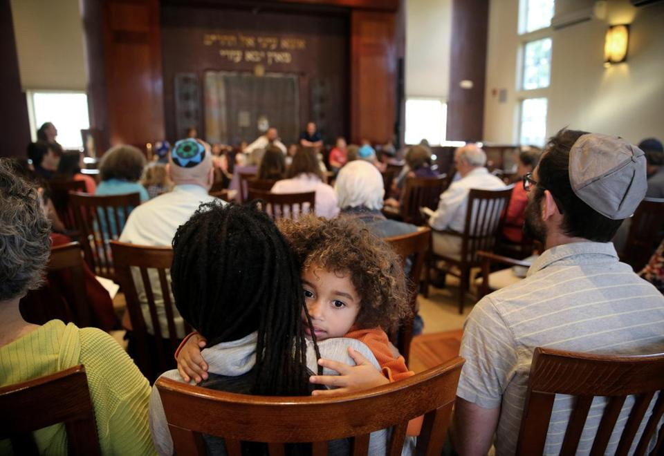 Ezrah Fishman, 3, sat with his parents during a Kabbalat Shabbat service in May.