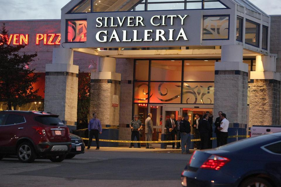 Officials surrounded an entrance to Silver City Galleria in Taunton on Tuesday evening.
