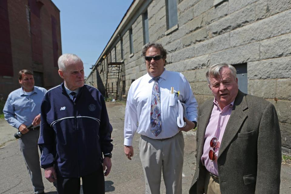 BOSTON, MA - 5/12/2016: - Frontier Enterprises (developer) Joseph Timilty Jr. Joseph Timilty Sr withThe Architectural Team Stephen Caswell, archtiect Robert J. Verrier, vice president, managing principal.The renovating the old 'ropewalk' facility at the Charlestown Navy Yard, turning it into high end housing. Joe Timilty is renovating the old 'ropes factory' at the Charlestown Navy Yard, turning it into high end housing. (David L Ryan/Globe Staff Photo) SECTION: BUSINESS TOPIC 17ropefactory