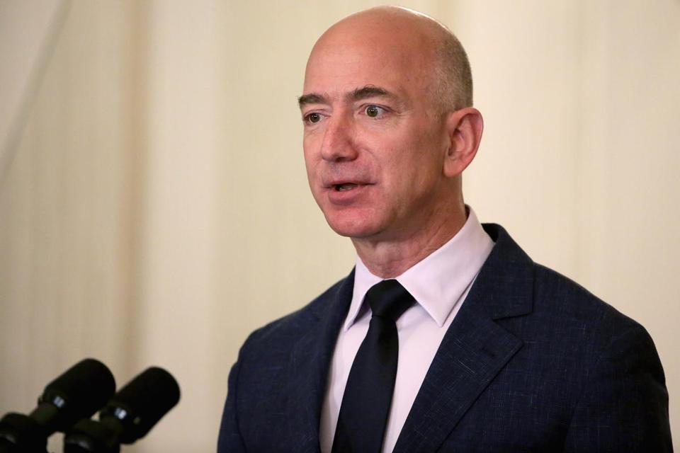 WASHINGTON, DC - MAY 05: Amazon founder and CEO Jeff Bezos delivers remarks during an event announcing commitments from more than 50 companies that have pledged to hire and train veterans and military spouses in the State Dining Room at the White House May 5, 2016 in Washington, DC. On the fifth anniversary of first lady Michelle Obama and Dr. Jill Biden's military hiring initiative Joining Forces, Bezos announced a commitment by his company to hire 25,000 more military veterans in the next five years. (Photo by Chip Somodevilla/Getty Images)