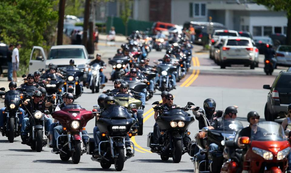 Riders headed along Salem Street in Revere on Saturday. More than 6,000 motorcycle riders flooded Suffolk Downs to honor five wounded veterans.