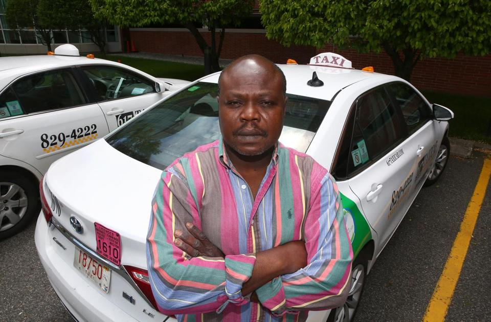 Celestin Couyoute is one of many Boston-area taxi medallion owners who are feeling the pressure of declining income and high loan repayment costs.