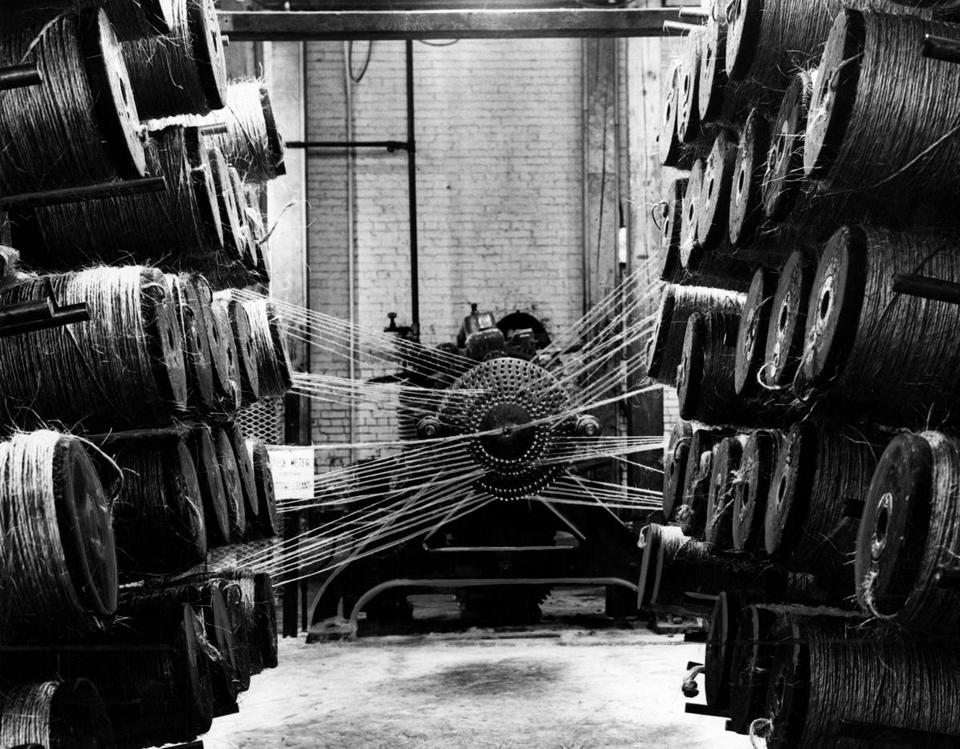 BOSTON - String - like yarns are fed into a mixmaster-type machine which twists them together to make a single thread at the Ropewalk complex in the Charlestown Navy Yard in Boston. (Metro Group Editorial Service/) --- BGPA Reference: 160519_MJ_003