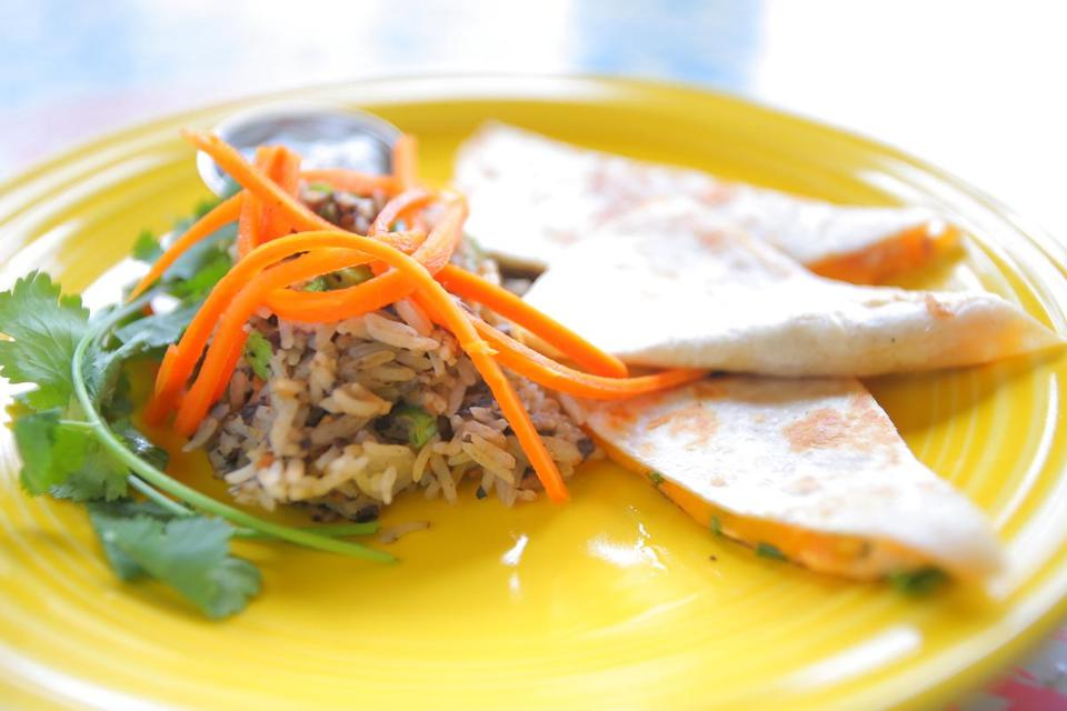 Salmon quesadilla with coconut rice and gingered carrots at The Gallery Cafe, a new art-themed restaurant in Littleton.