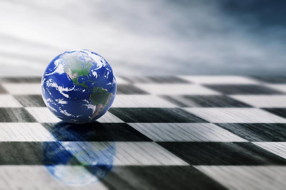 world on a chessboard isolated on blue sky background. Elements of this image furnished by NASA; Shutterstock ID 257102155; PO: oped