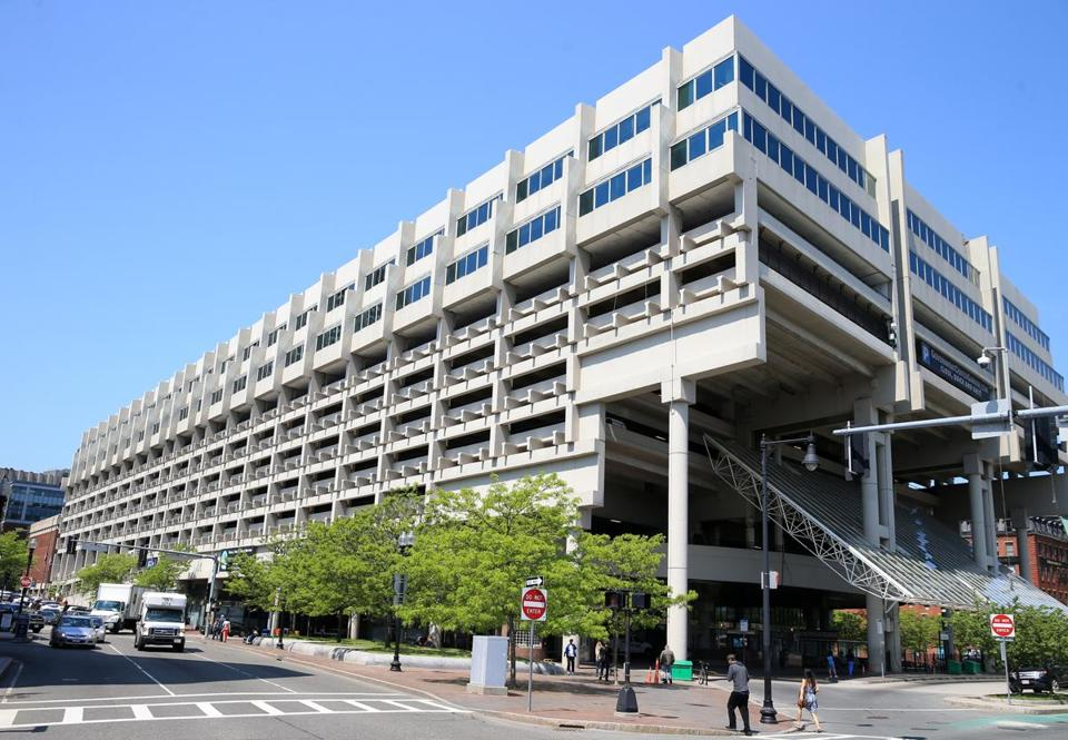 When the project is completed, the Government Center Garage (left) will essentially be wrapped by the lower floors of an office tower and two apartment buildings.
