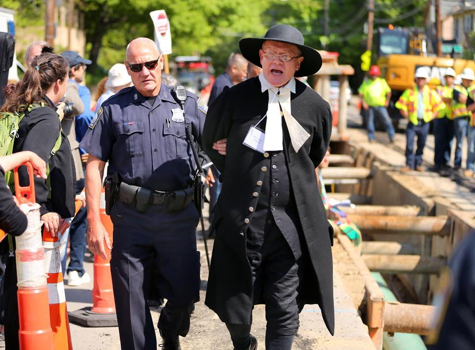 West Roxbury -5/25/16- Over a dozen clergy were arrested , including Rev. John Gibbons from The First Parish in Bedford, .at the West Roxbury Lateral Pipeline construction site on Grove Street as they sat on the edge of the 16 inch gas pipeline being laid five feet below the street, and halted the work from being done. Boston Globe staff Photo by John Tlumacki (metro)