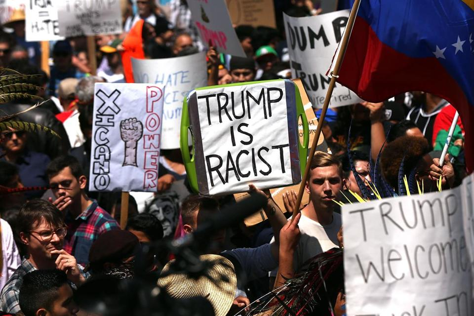 Demonstrators protested outside of an arena in San Diego Friday where Republican presidential candidate Donald Trump held a campaign rally.
