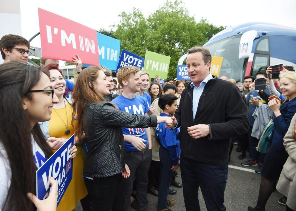 epa05337337 British Prime Minister David Cameron (R) greets supporters during the launch of the battle bus for the 'Remain In' campaign at Froebel College of the University of Roehampton in London, Britain, 30 May 2016. Khan and Cameron will continue to campaign around the United Kingdom in the lead up to the EU referendum on 23 June. EPA/FACUNDO ARRIZABALAGA / POOL
