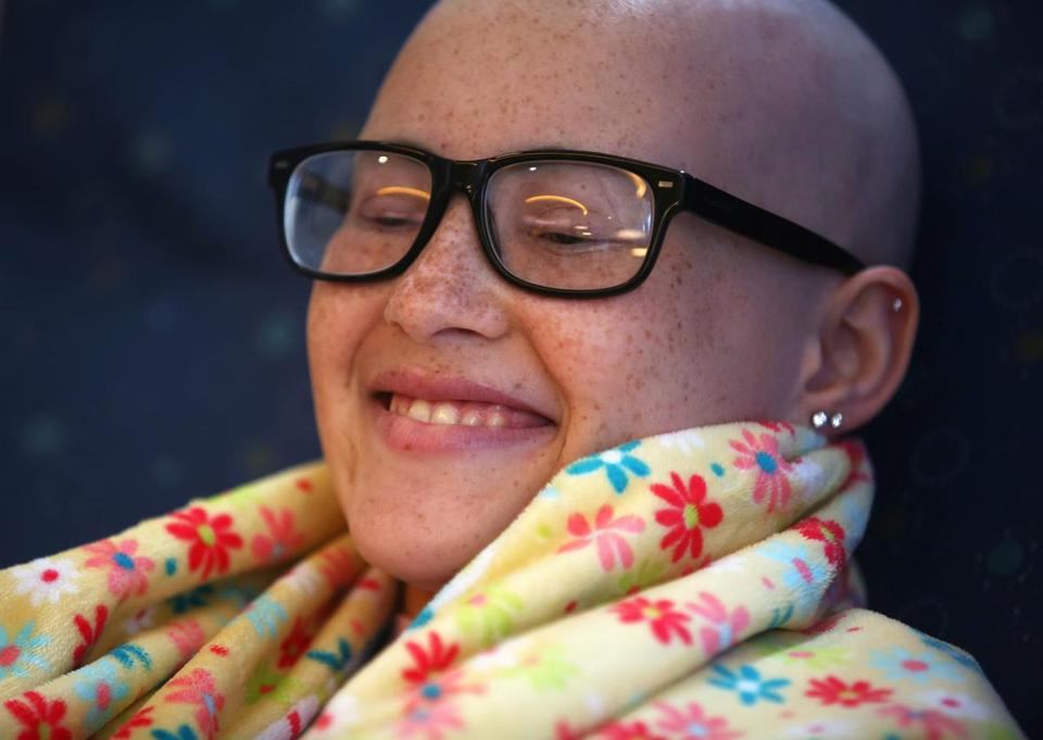 Carlie Gonzalez, 15, who has Ewing's sarcoma, reacted to the reflexology being performed on her feet.