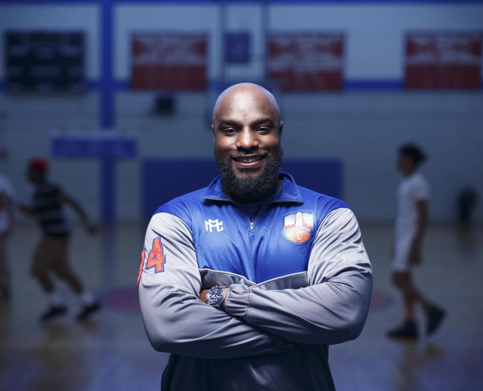 ****Not for other use until Magazine first publishes on June 12 2016**** 5/31/16 - Charlestown, MA - Charlestown High School - Peter Edouard, cq, is the founder and CEO of MathMatik Athletics, an athletic apparel company. He is photographed here in the gymnasium of his alma mater, Charlestown High School. Topic: 061216Firstv2. Story by Neil SwideyChase/Globe Staff. Photo by Dina Rudick/Globe Staff.