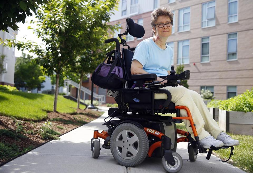 Karen Carson of Brighton fell out of her wheelchair while attempting to use a ramp leading to the City Council chamber to speak at a public hearing.