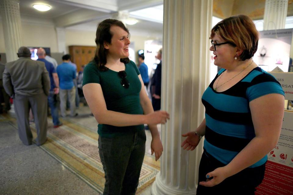 Naomi Wixon (left), of Worcester, and Jordan Evans (right), of Charlton — both transgender — spoke to each other at the State House.