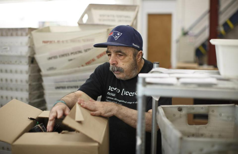 Darryl Vito sorted and packaged electronic cables during his shift at Triangle Inc. in Malden, as he worked on one of the workshop's final contracts.