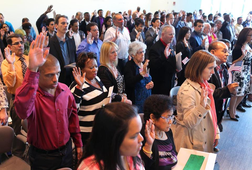 Ninety-eight people were sworn in as naturalized citizens at a ceremony at the Moakley US District Court.