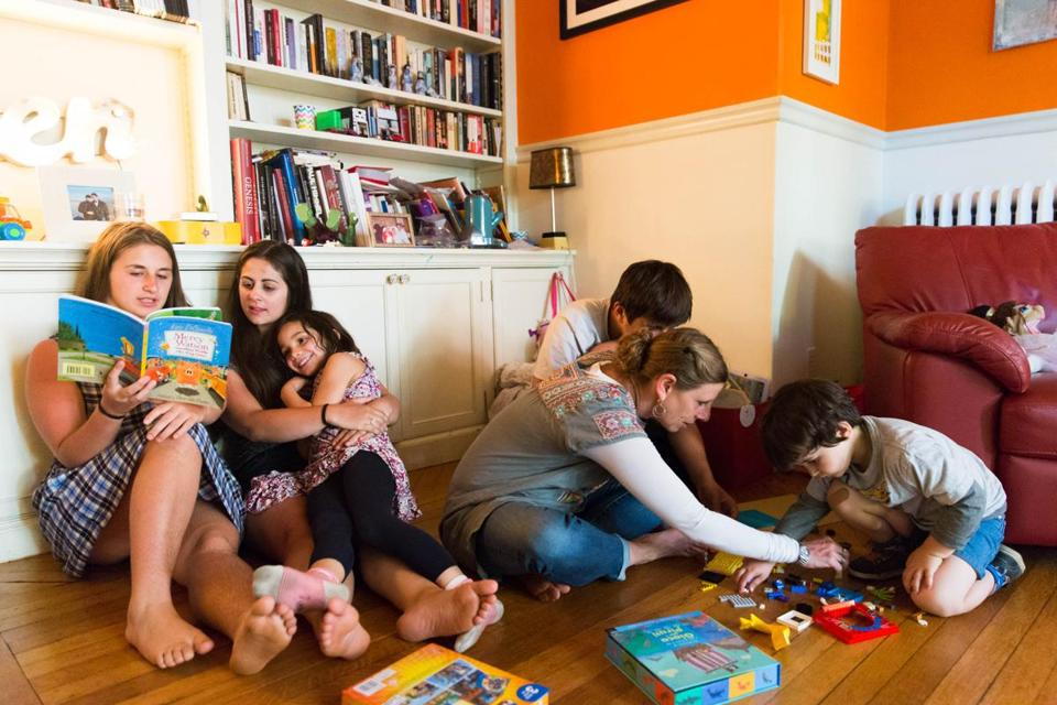 Jordan and Madeline Hurley read to Rachel Maria Sechi Mercer while Rachel Segall and Zeke Hurley play with Eleanora Sechi Mercer.