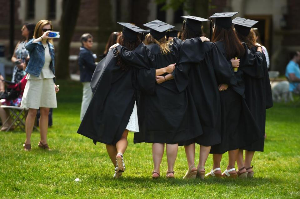 A group of graduates posed for a picture during the 2016 Trinity College commencement. The school has announced that undergraduate costs for the 2018-2019 academic year will top $71,000.
