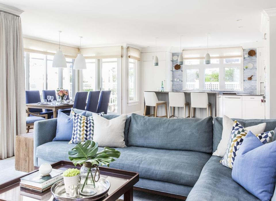 Multiple shades of blue are paired with linen tones to keep the airy space light and bright.