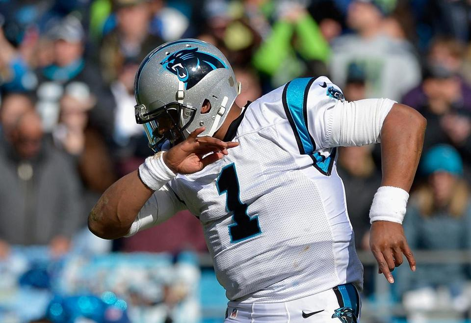 "Cam Newton of the Carolina Panthers shows his trademark ""dab"" during a playoff game last year in Charlotte, N.C."