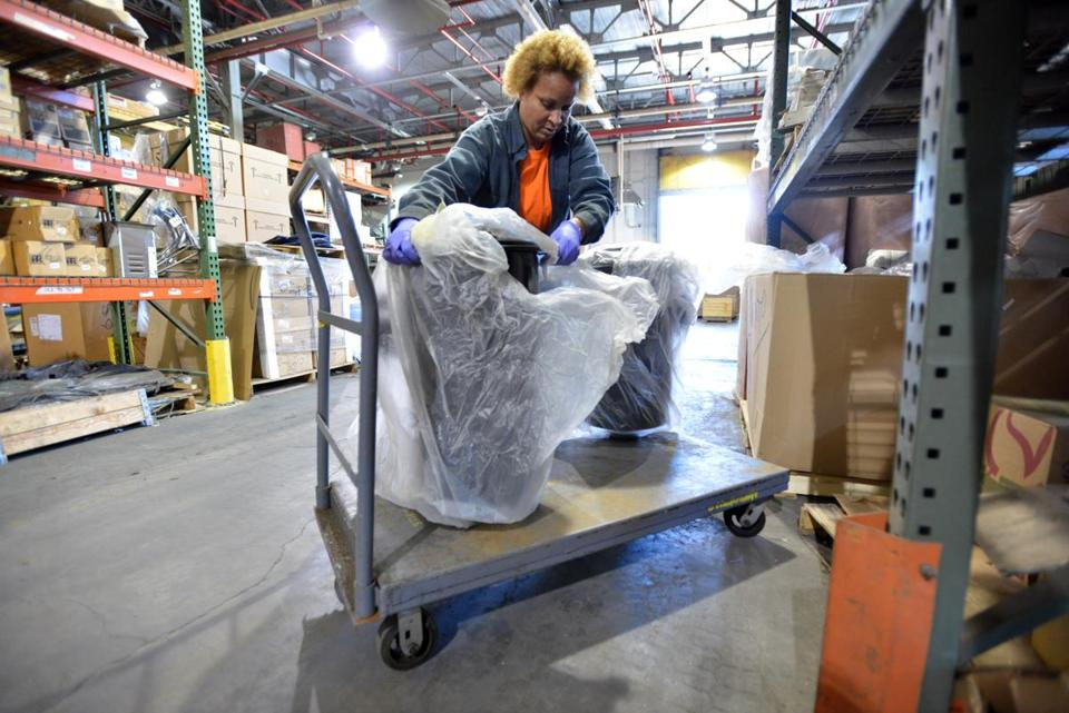 Giana Gibson, a stocker, moved a pair of air filters at the MBTA Central Warehouse in Everett.