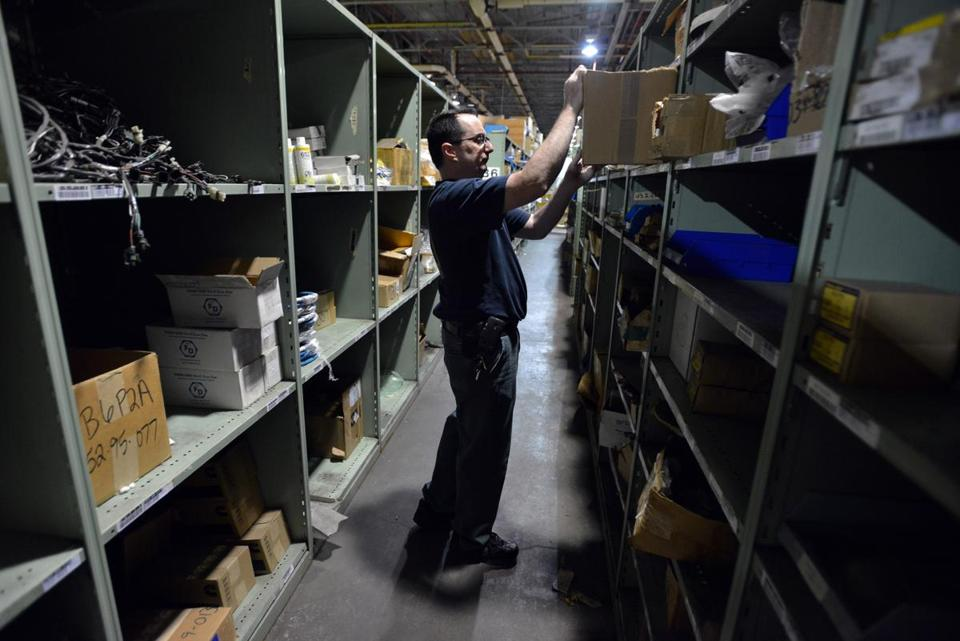 Employee Michael Herman pulled items off shelves at the MBTA Central Warehouse in Everett.