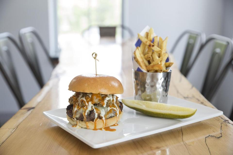 The Spicy Pig burger — with cheddar, hot sauce, and pork chili — and hand-cut fries.