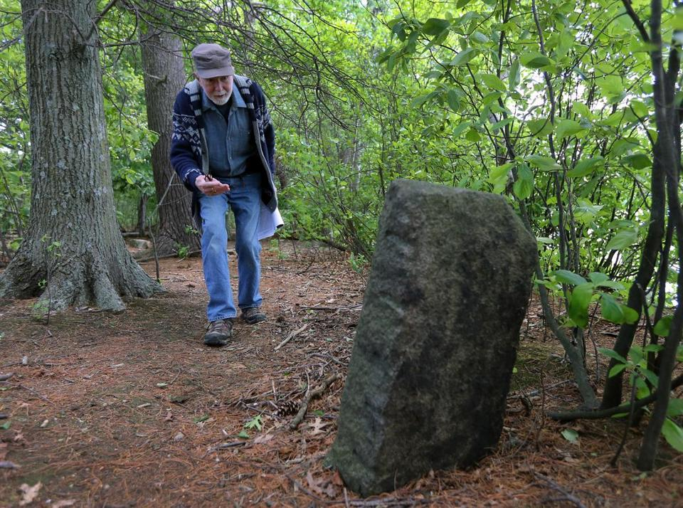Mike Ryan of Melrose, former executive director of the Friends of the Middlesex Fells Reservation, examined the Shute stone marker on a recent expedition to Great Island.