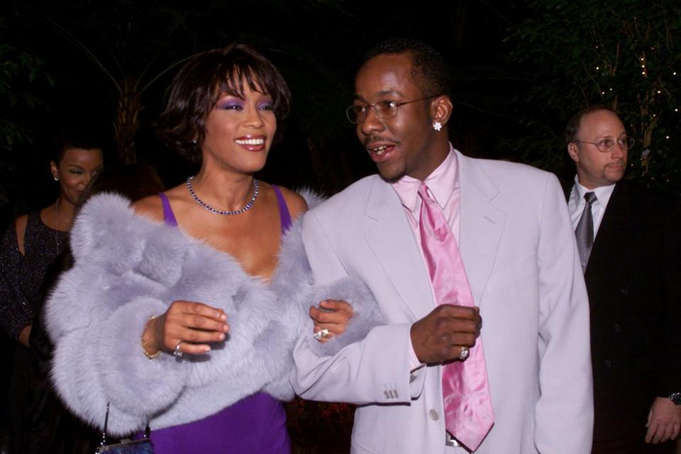 "Whitney Houston and Bobby Brown arrived at a pre-Grammy Awards party in 2000. In a memoir, ""Every Little Step,"" Brown claimed that Houston was bisexual."