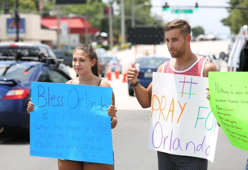 People held a vigil outside the Orlando Regional Medical Center Sunday.