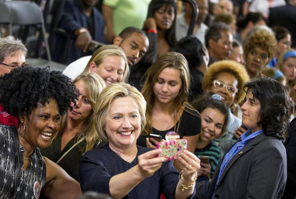 Democratic presidential candidate Hillary Clinton took a selfie with members of the audience after speaking at a rally in Cleveland on June 13, 2016.