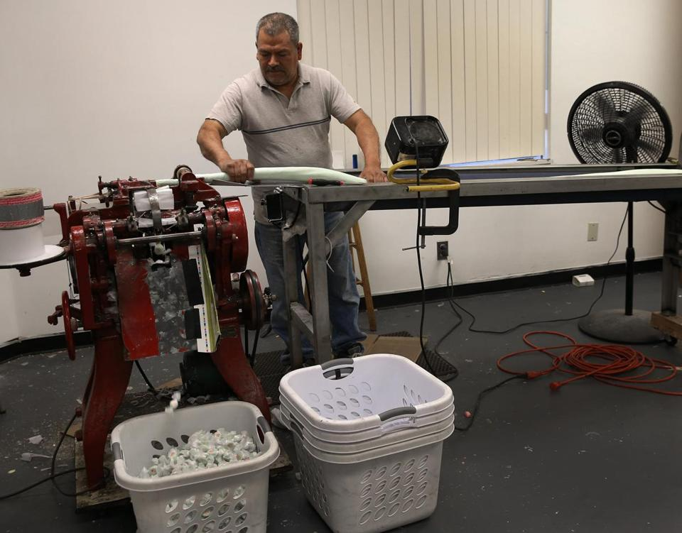Jose Torres operated a machine that slices and wraps the candy.