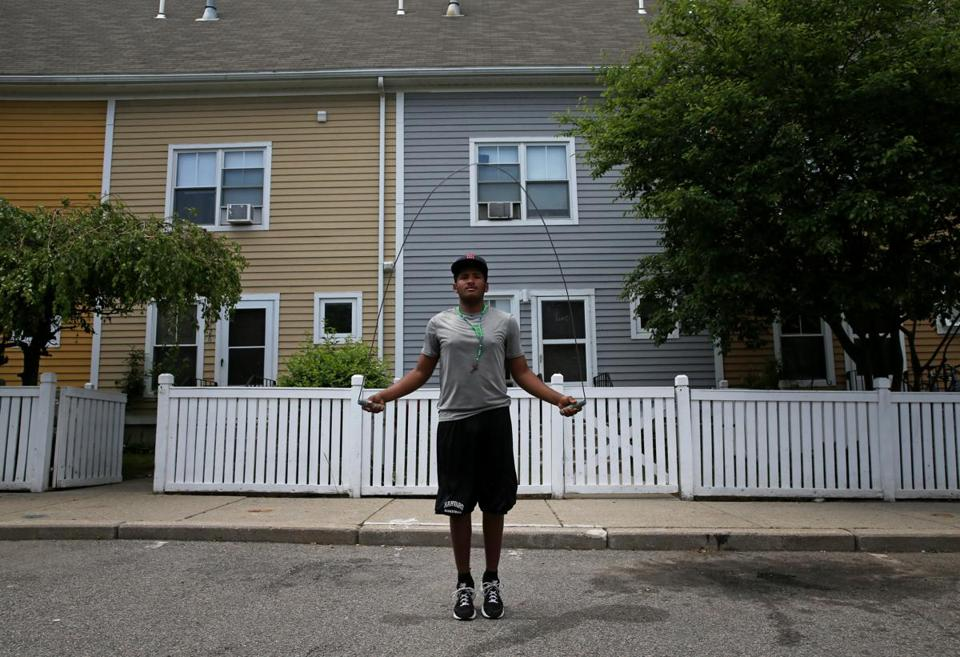 Rafael Tejeda, 16, jumped rope outside his home in Orchard Gardens, a desirable low-income housing development.