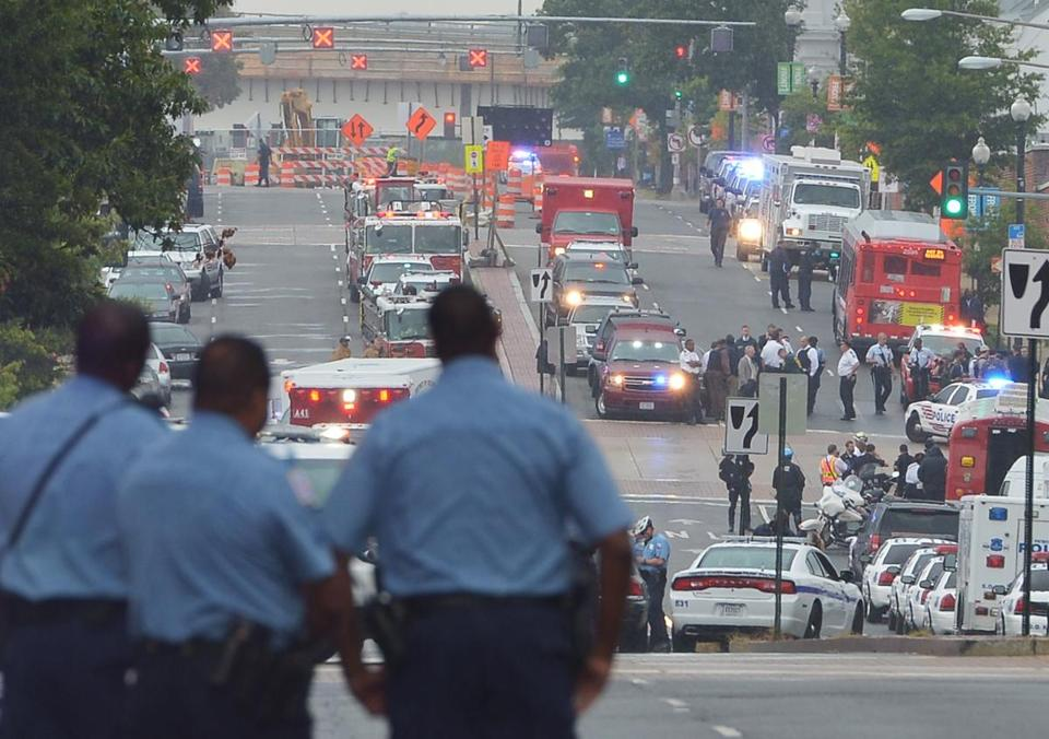 Law enforcement officials worked in the aftermath of a shooting at the US Navy Yard in Washington, D.C., in 2013.