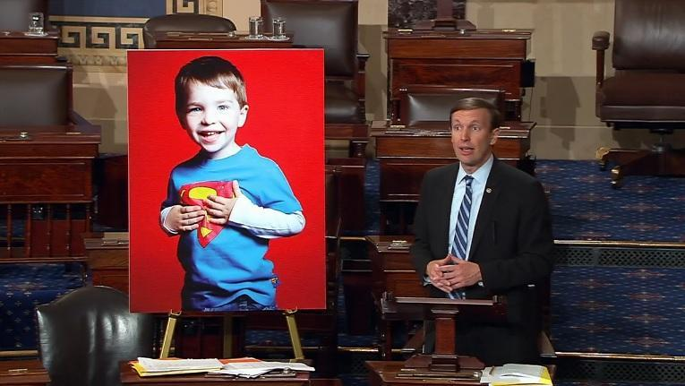 Senator Christopher Murphy with a portrait of a victim from the Sandy Hook Elementary School shooting during Murphy's filibuster on Thursday morning.