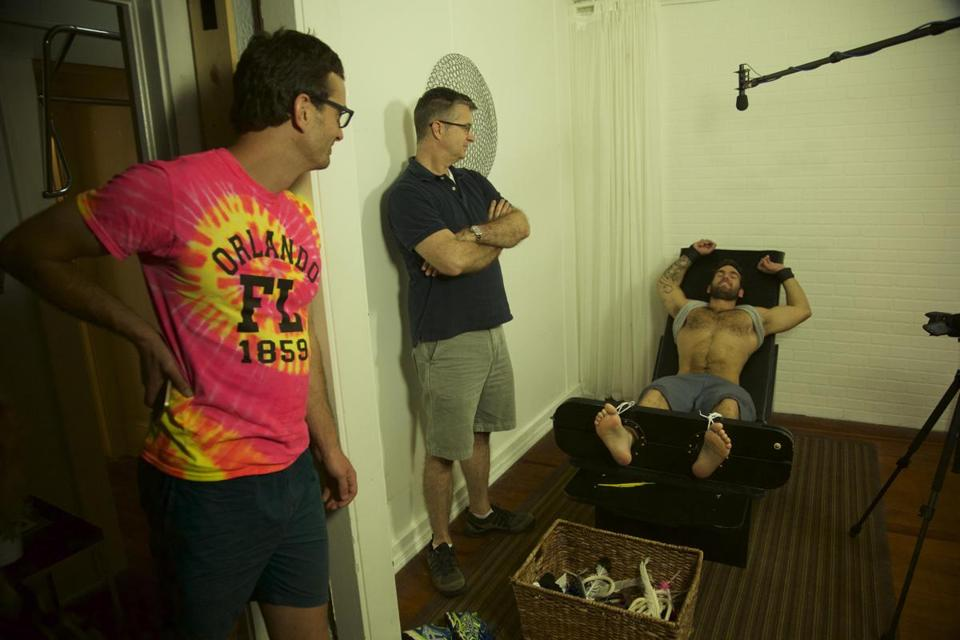 "David Farrier, Richard Ivey, and a tickle subject in ""Tickled."""