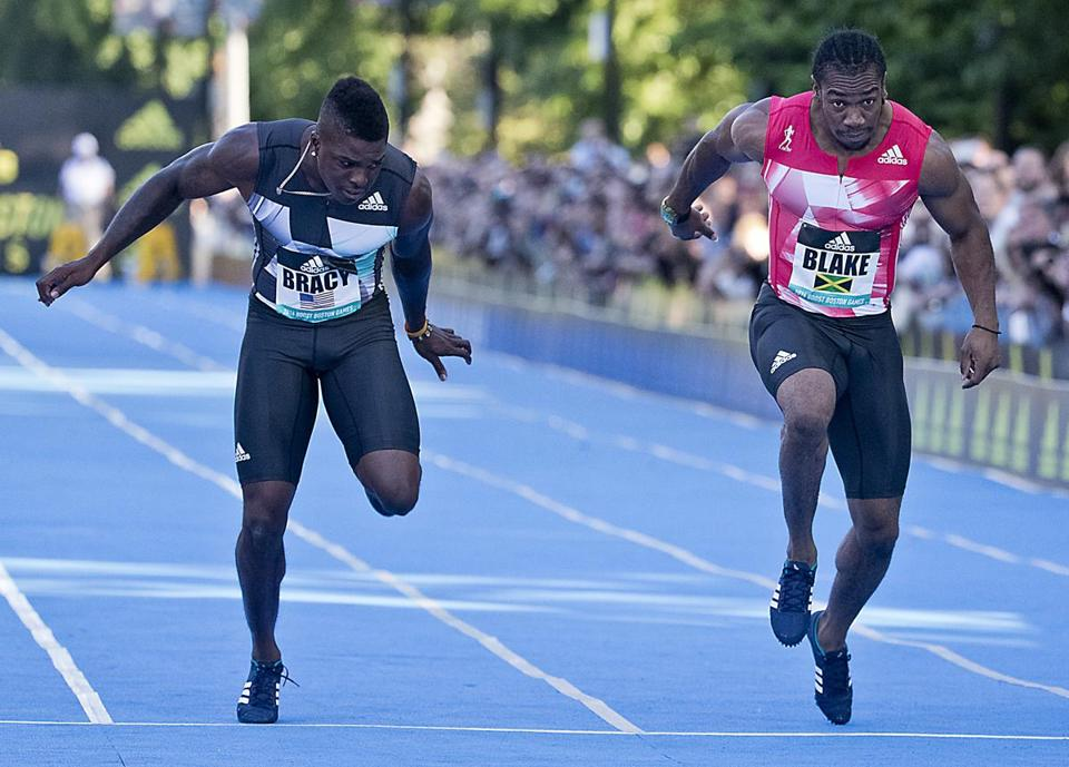 Boston MA 6/18/16 Marvin Bracy from USA edges Yohyan Blake from Jamaica at the finish line during the Street Meet competition on Charles Street between Public Garden and Boston Common on Saturday June 18, 2016. (Photo by Matthew J. Lee/Globe staff) topic: reporter: