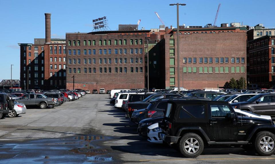 BOSTON, MA - 2/02/2016: Big parking lot that stretches out towards the Gillette Complex down the channel. GE may be going there for its permanent HQ. 253 Summer is a building that cuves along Melcher Street in Fort Point, from Summer down to Necco St. In the background are the two empty warehouse buildings behind it, on Necco Ct. A (David L Ryan/Globe Staff Photo) SECTION: BUSINESS TOPIC 04summer(2)