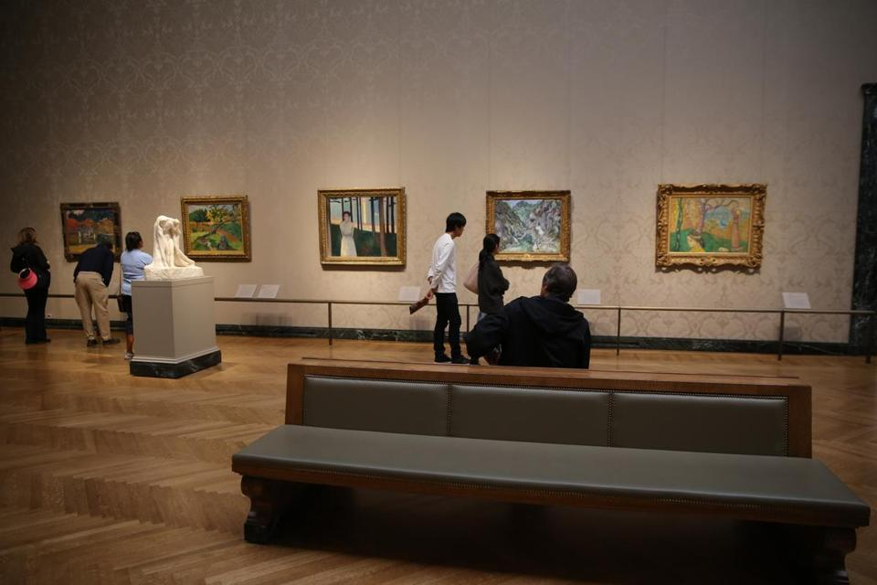 Museumgoers view 19th-century French art in the MFA's Sidney and Esther Rabb Gallery.