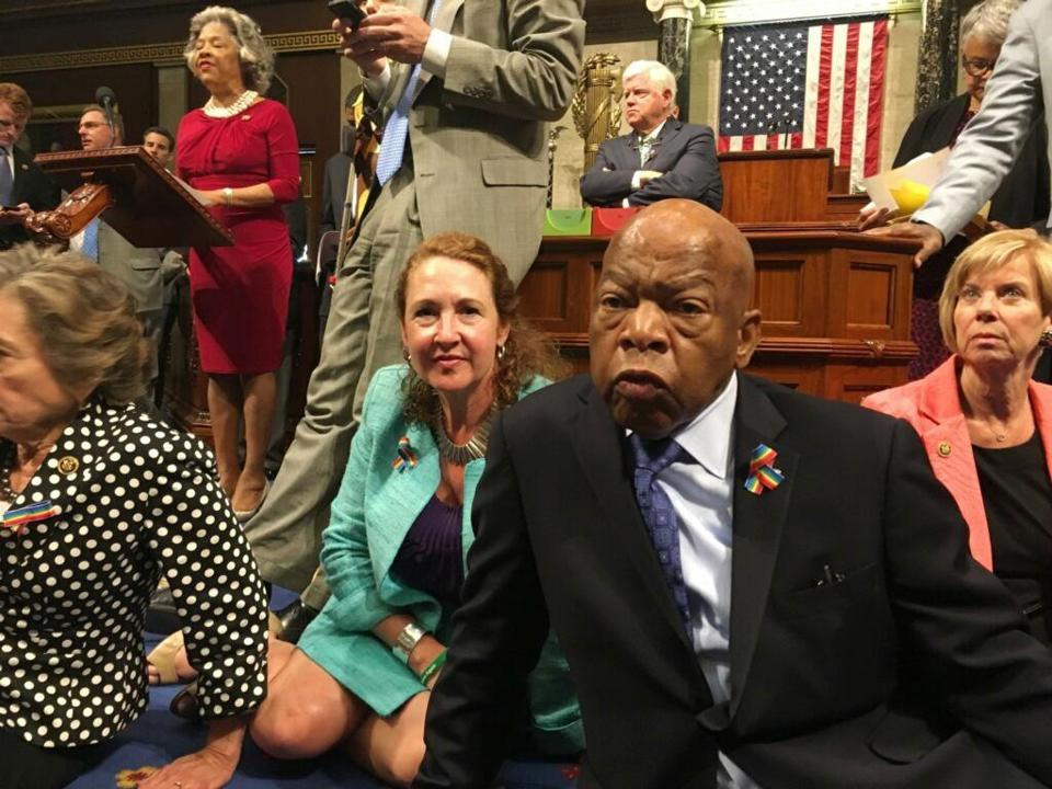 This photo provided by Rep. Chillie Pingree,D-Maine, shows Democrat members of Congress, including Rep. John Lewis, D-Ga., center, and Rep. Elizabeth Esty, D-Conn. as they participate in sit-down protest seeking a a vote on gun control measures, Wednesday, June 22, 2016, on the floor of the House on Capitol Hill in Washington. (Rep. Chillie Pingree via AP)