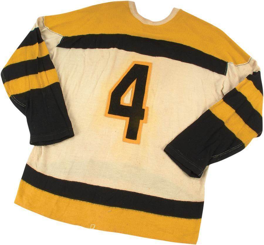 A No. 4 Bruins jersey worn by hard-hitting defenseman Bob Armstrong has sold for nearly $20,000, according to the online auction house Lelands.com.