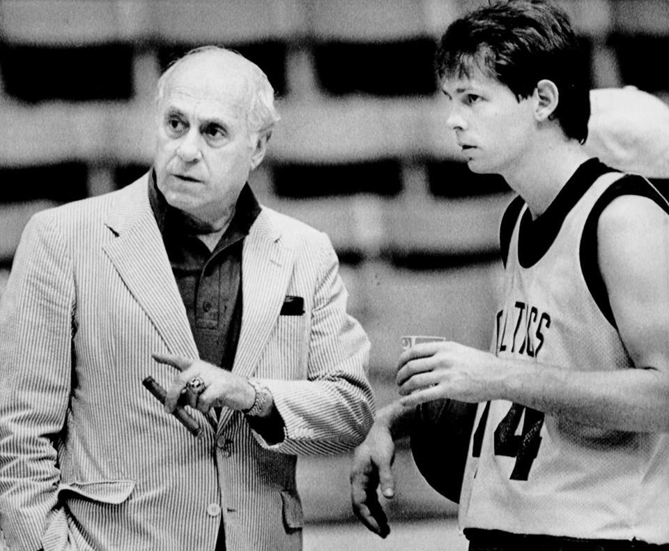 "Sports Print scan/ A.P. photo 5/26/1985 *** ""Red Auerbach"" Boston Celtics President and General Manager talks with Danny Ainge Boston Celtic guard."