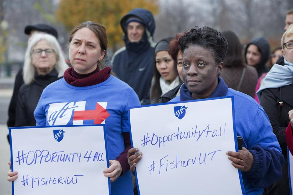 Members of the American Federation of Teachers rally in support of affirmative action outside of the Supreme Court in Washington, Wednesday, Dec. 9, 2015, as the court hears oral arguments in the Fisher v. University of Texas at Austin affirmative action case. (AP Photo/Jacquelyn Martin)