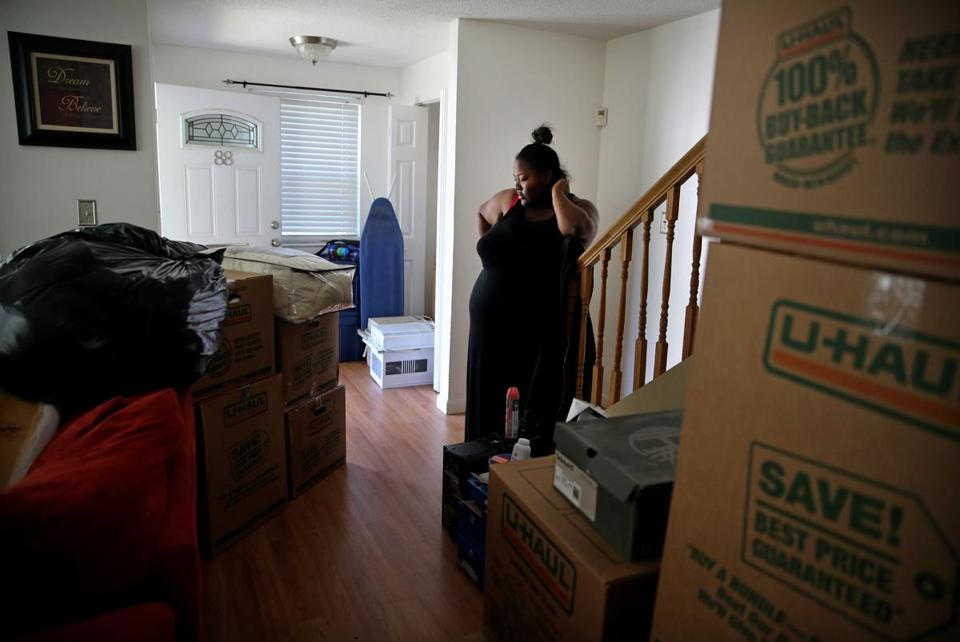 Shantel Young looked over the living room of her family's new, larger home in Dorchester.