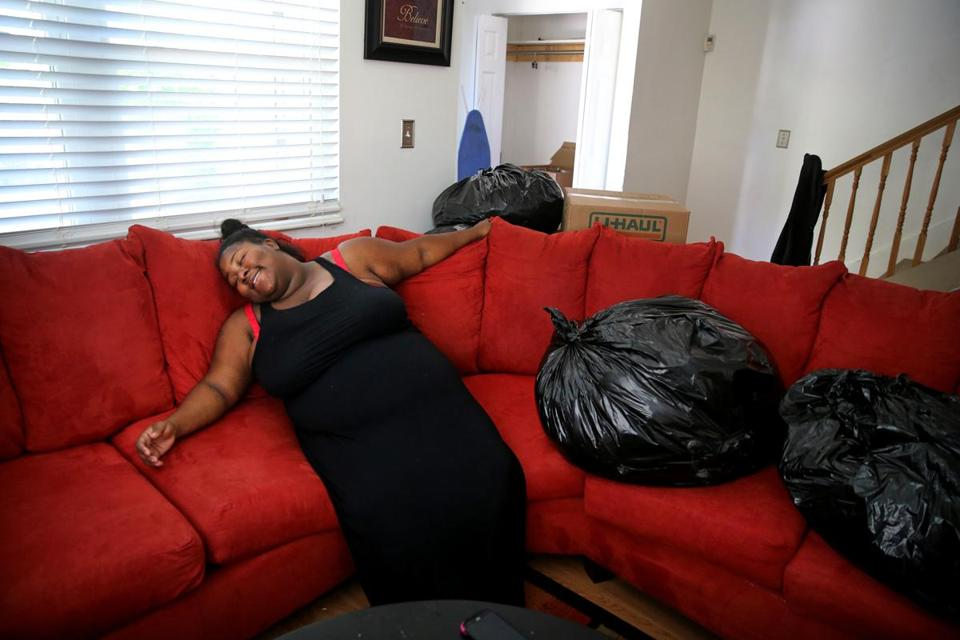 "Shantel Young got a chance to relax after the movers left her family's new three-bedroom home in Dorchester. It took her a long time to find a suitable bigger place to live, and one of her goals was finding a safer neighborhood. ""I want to make sure that wherever we move, it isn't, like, drug activity at the front door,"" she said."