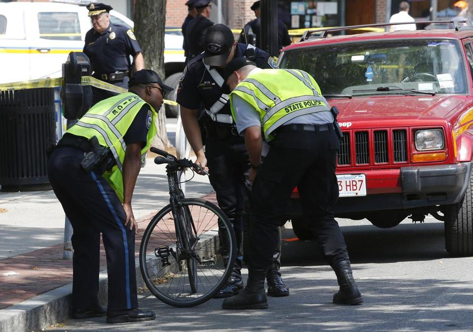 Police lifted the bicycle that was involved in a crash in the Inman Square section of Cambridge.