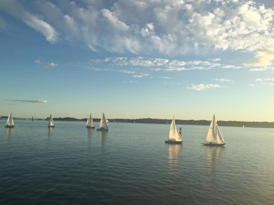 Sailboats drifted by Rose Island in the late afternoon and early evening.
